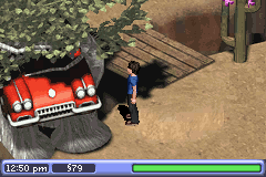Sims 2, The - Location  - A car wedged between two trees. - User Screenshot